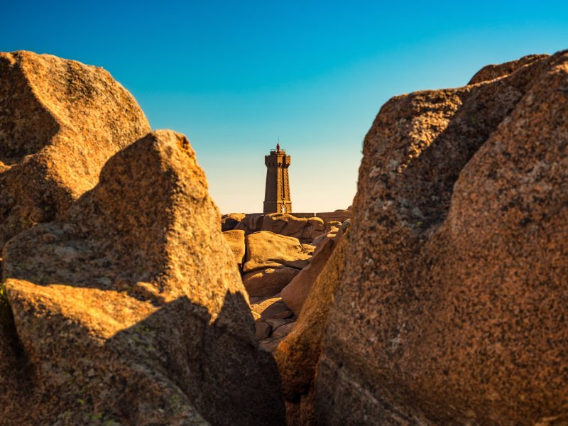 Ploumanac'h lighthouse between the rocks in pink granite coast,